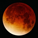 The moon turning a deep red during a total lunar eclipse in November 2003.