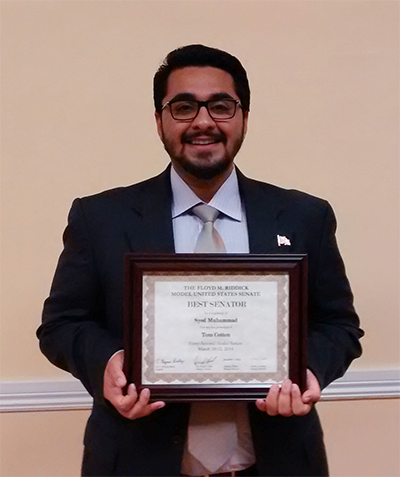 Syed Muhammad Omar with award