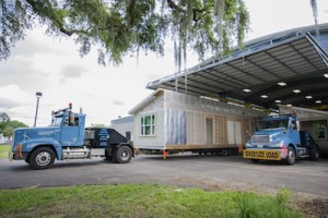 Santa Fe College, Habitat for Humanity and the Builders Association of North Central Florida working together to load and ship the 6th Santa Fe Habitat House in the SF Charles R. Perry Construction Institute on Thursday, May 19, 2016. Photos by Aaron Daye/Santa Fe College