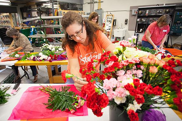 Jessie wraps a carnation