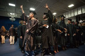 Jonathan Vann and Jeremy Gates (Both have photo release signed) waves to the crowd during the Santa Fe College Fall Commencement Ceremony on Friday, Dec. 9, 2016 in Gainesville, Fla. (Photo by Matt Stamey/Santa Fe College)