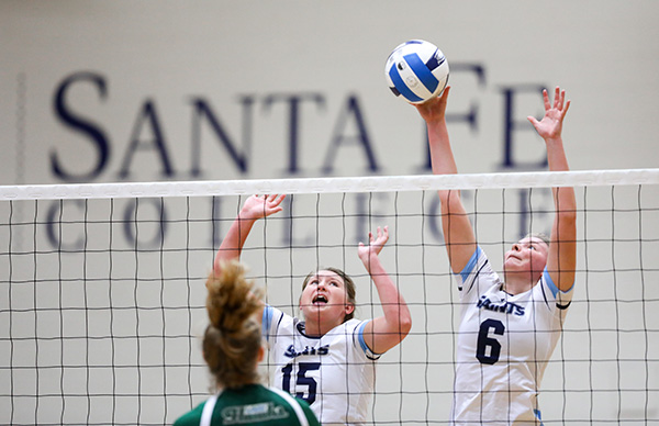 Meagan Irish and Maggie Mathews jump to block a shot. The Santa Fe College Saints defeated Lake Sumter State College in three sets on Wednesday, August 23, 2017 in Gainesville, Fla. (photo by Matt Stamey/Santa Fe College)