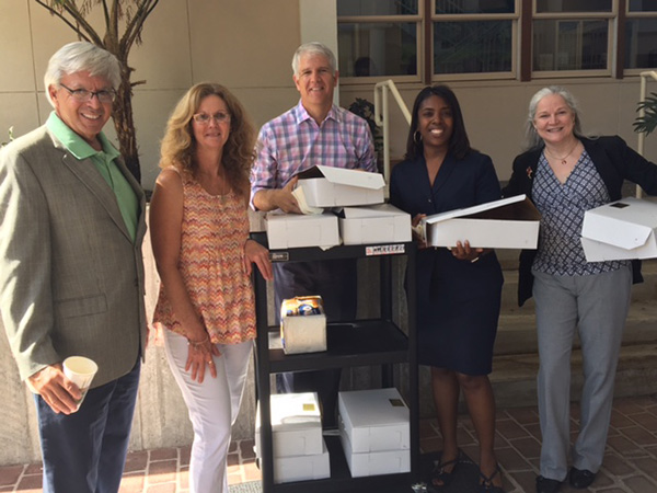 From left: Dr. Sasser, Tina Crosby, Dr. Bonahue, Dr. Brown and Dr. Armour helping distribute muffins to the SF staff for a successful first week.