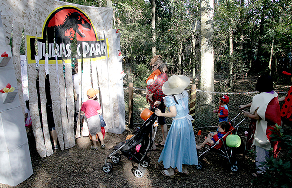 Visitors to Boo at the Zoo at Santa Fe College entering a Jurasic Park themed exhibit