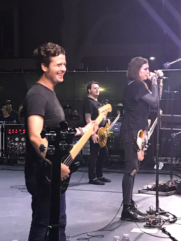 Against Me band members Dustin Fridkin, James Bowman and Laura Jane Grace.
