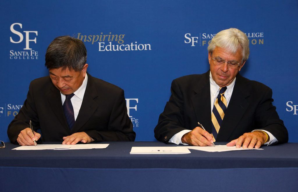 JPEC President Huang Zujie and SF President Jackson Sasser singing the articulation agreement.