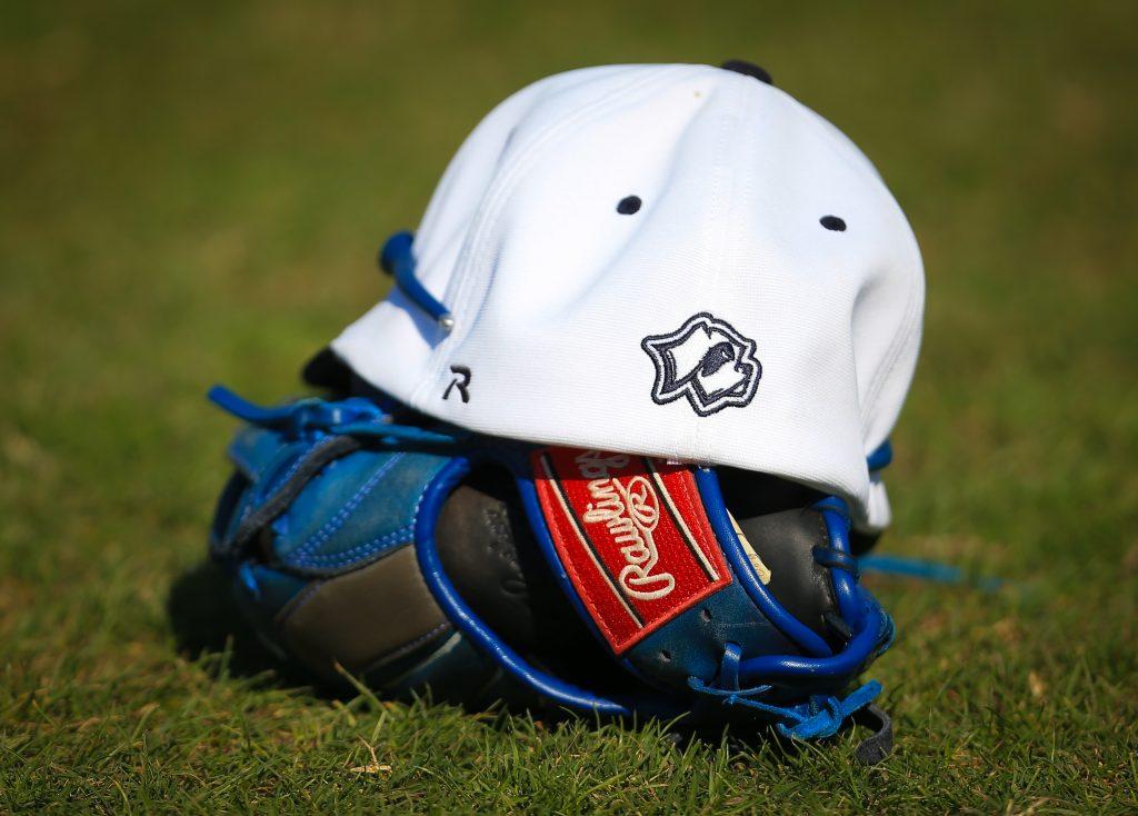 Santa Fe Saints baseball cap and glove