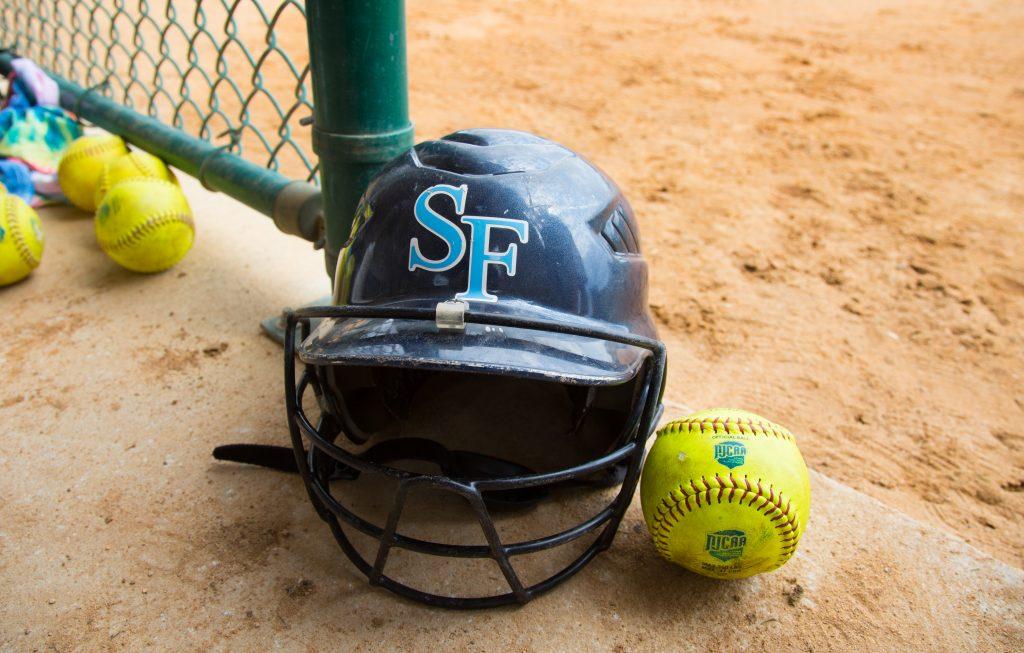 Saints softball batting helmet and softball.
