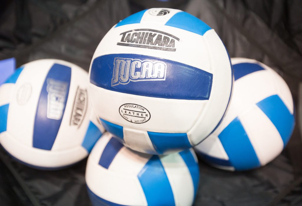 Four volleyballs with the NJCAA logo on them.