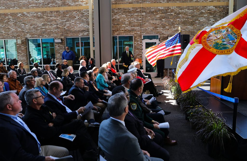 The crowd watches a simulation during dedication of the Institute of Public Safety at the Santa Fe College Kirkpatrick Center on Friday, March 23, 2018