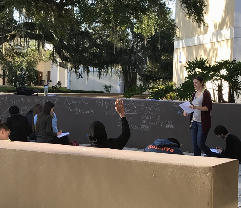 SF mathematics professor Lorisha Riley holds her 8 a.m. class outside during Wednesday morning's power outage on the Northwest Campus.