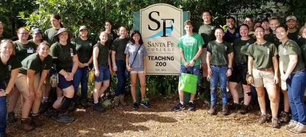 Santa Fe College Teaching Zoo students gather around Scott Shanbom (light green shirt) as the millionth person to visit the zoo.