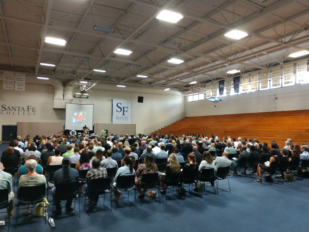 Family and friends attend the memorial service for Manny Hernandez