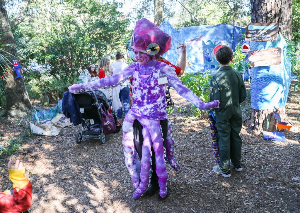 Families make their way through the Santa Fe College Teaching Zoo during the annual Boo at the Zoo event on Tuesday Oct. 31, 2017 in Gainesville, FL. Zoo faculty, staff and students dress in costumes and pass out candy to trick-or-treaters.  (photo by Matt Stamey/Santa Fe College)