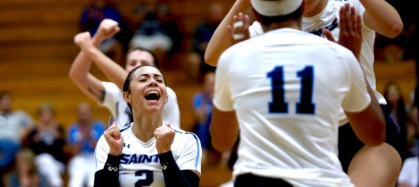 Saints Volleyball players celebrate during their opening night win against Lake Sumter.