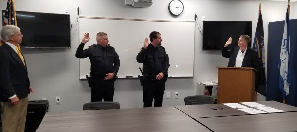 Bobby Bridgeman and Kevin Hall taking the SFPD Oath of Office.