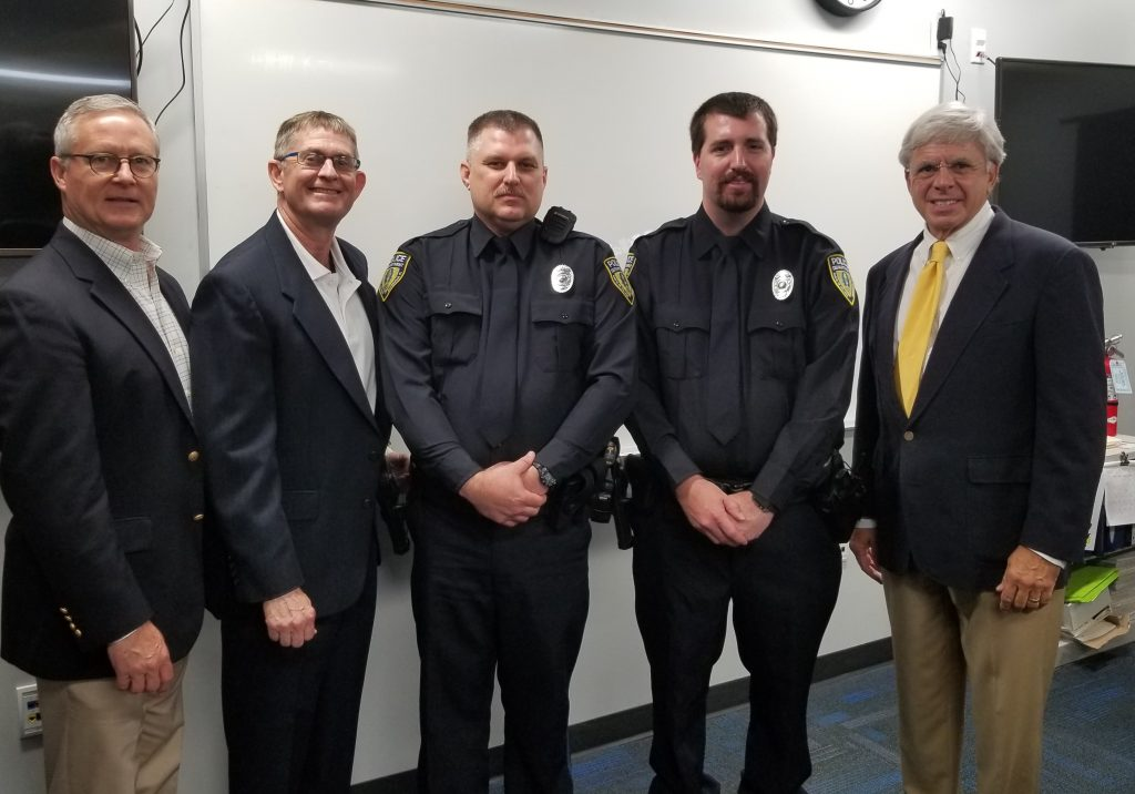 VP for Advancement Chuck Clemons, SFPD Chief Ed Book, Officer Bobby Bridgeman, Officer Kevin Nash and President Jackson Sasser at the swearing in of the two new SFPD officers.