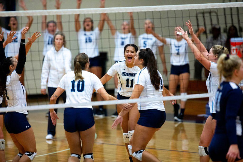 Santa Fe Saints Volleyball Brooke Ruud (11) celebrates with teammates