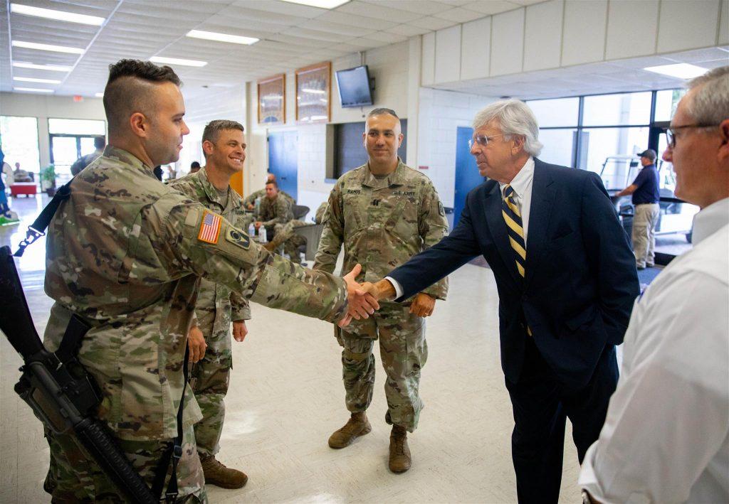 SF President Jackson Sasser greeting members of the U.S. National Guard.