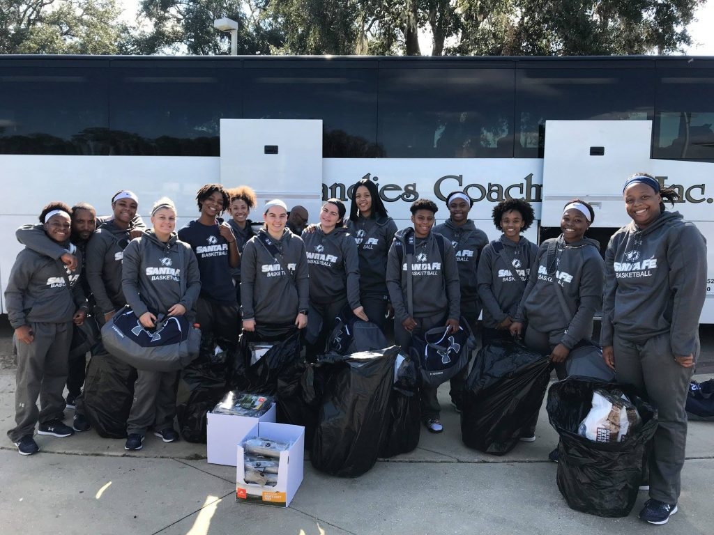 The Santa Fe Saints women's basketball team take supplies up to the area impacted by Hurricane Michael