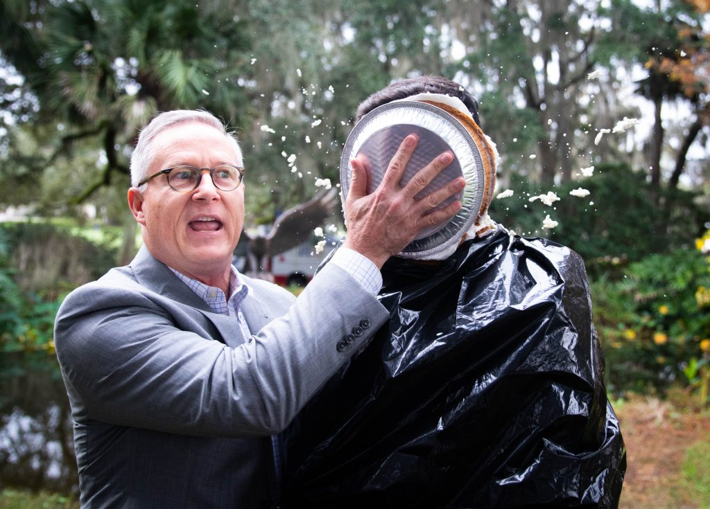 Santa Fe College Vice President for Advancement Chuck Clemons won the annual United Way Penny Wars giving him the honor of throwing a pie in the face of SF Student Body President Alejandro Puga.