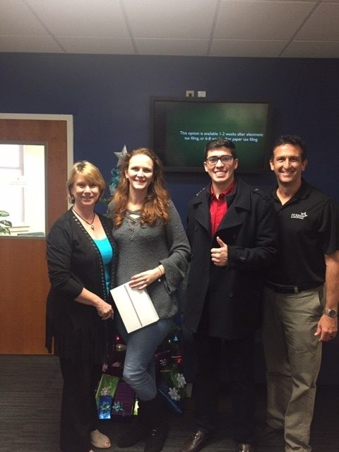 Stephanie Holt (second from the left) is with Cheryl Farrell, Alejandro Puga and Doug Bagby after being announced the winner of the iPad in SF's United Way fundraising campaign.
