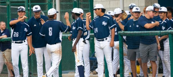 Santa Fe Saints baseball players celebrate a win.