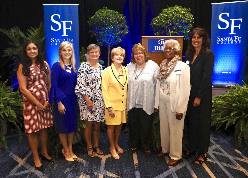The 2019 honorees (left to right) Nilanjana Sengupta Caballero, Emily Acevedo (Woman of Promise), Linda Lee, Layne Sasser (Honorary Woman of Distinction), Carol Bosshardt, Gussie Lee and Fran Maris.