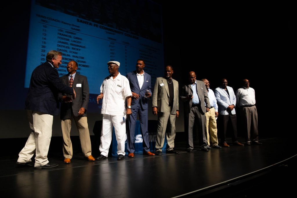 Athletics Director Jim Keites with the 1980-81 Men's Basketball Team during the Santa Fe Saints Athletics Hall of Fame Enshrinement Ceremony April 13, 2019.