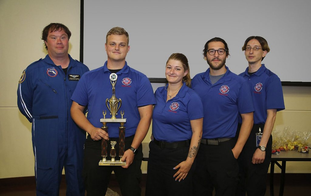 Paramedic instructor Greg Welch with students Kyle Boatright, Kacey Brooker, Kevin Hicks and Michael Anechiarico following SF's third-place finish in the statewide competition.