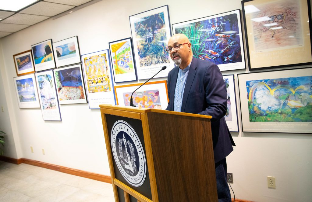 Raul Villarreal speaks during a reception to recognize Spring Arts Festival poster artists on Friday, Sept. 21, 2018 in Gainesville, Fla.