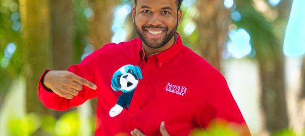 Javan Brown, SF Brand Ambassador for July 2019posing with a plush Caesar mascot.