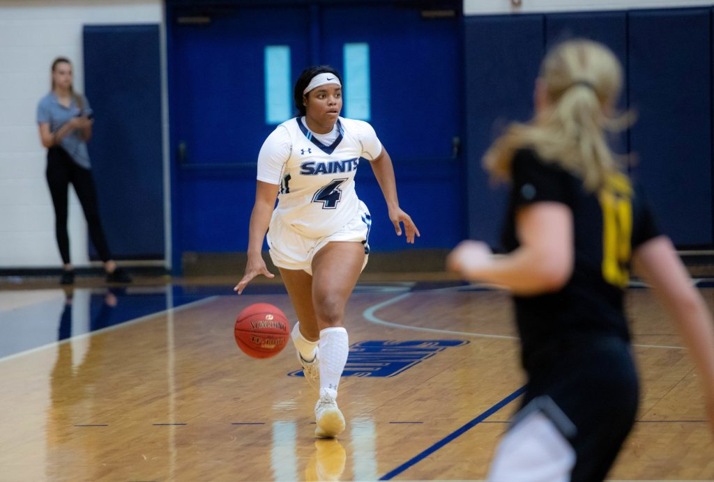 Sf basketball player Chardell Jones dribbling the ball down the court.