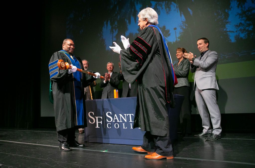 Dr. Sasser (at right) presents Dr. Broadie with the college mace during spring convocation.