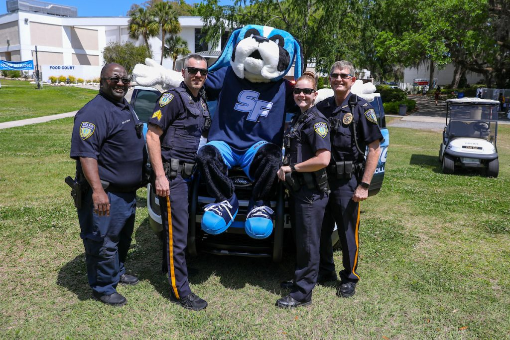 Caesar the Santa Fe College mascot with officers from the Santa Fe College Police Department