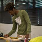 Students in SF's Davis Center make guitars as part of their Wide World of Science class.