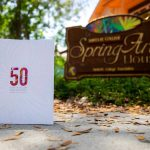 The 50th Anniversary Spring Arts Festival book photographed outside the SF Spring Arts House.